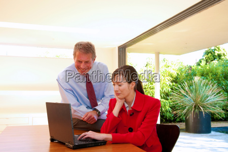 business couple look at computer