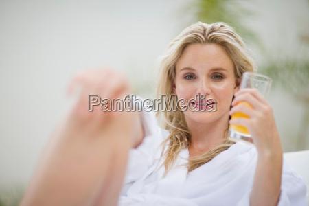 portrait of a woman drinking orange