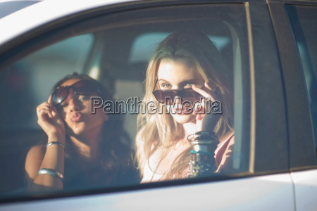 two girls with shades in car