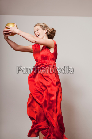 woman dancing with a golden ball