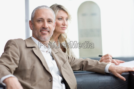 business people sitting in lobby area