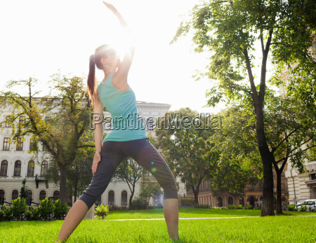 woman stretching in urban park