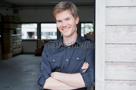 smiling man standing in garage
