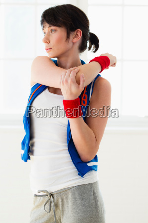 woman stretching indoors