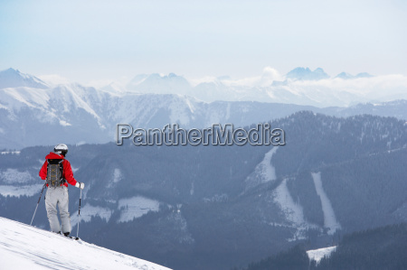 male skier standing on slope