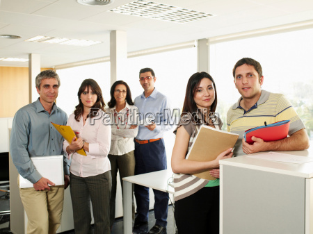 six business colleagues standing in office