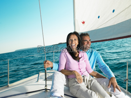 mature couple sitting on deck of