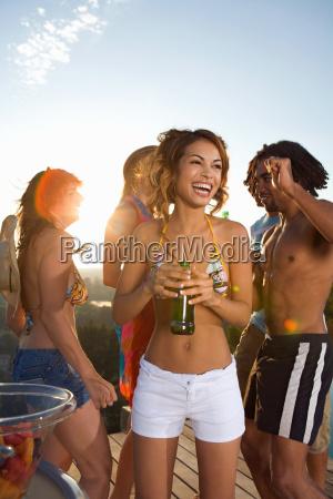 men and women dancing on terrace
