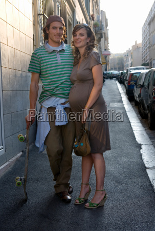 pregnant young woman and man in