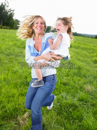 mother and daughter playing in a
