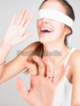 woman blindfolded smiling