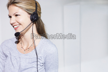 woman with telephone headset smiling