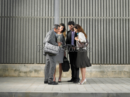 two businesswomen and two businessmen