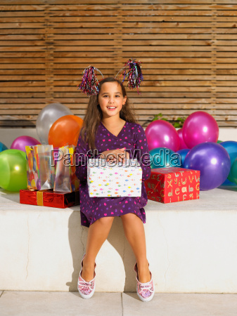 girl 8 10 with birthday presents