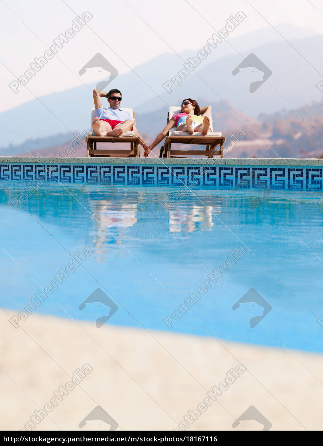 couple, sunbathing, by, swimming, pool - 18167116