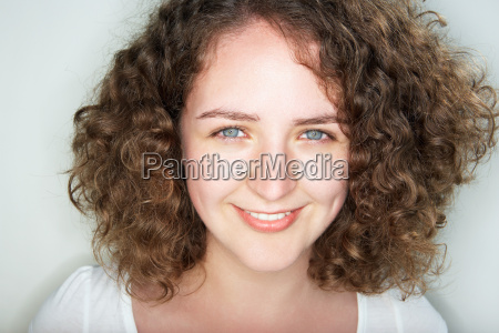 young female with curly hair
