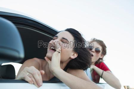 woman shouting through car window
