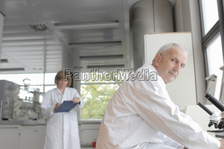 scientists working in laboratory man with