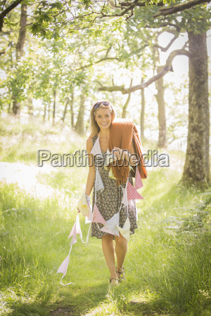 young woman walking with bunting in