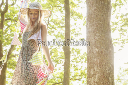 young woman with bunting in forest