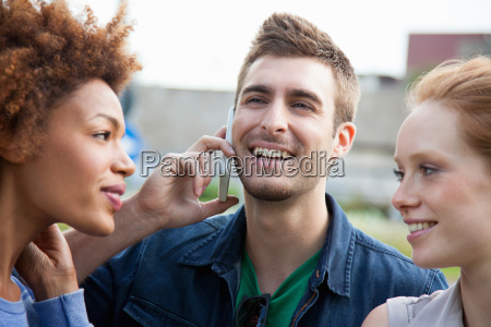 three young adult friends one talking