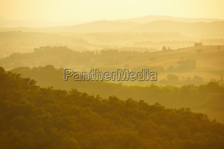 rural landscape at sunset tuscany italy
