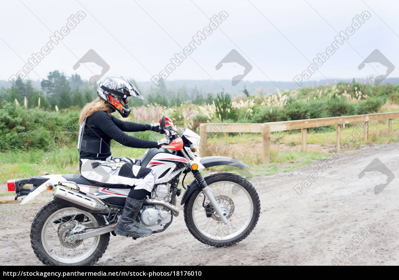 mid, adult, female, motorcyclist, riding, on - 18176010