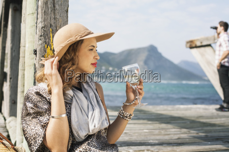 young glamorous woman drinking wine on