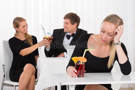 depressed woman sitting in restaurant