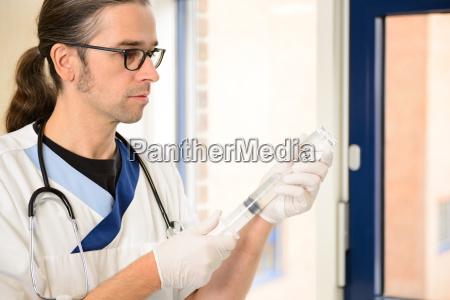 male nurse prepare a liquid medicament