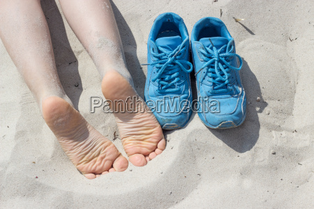 bare feet and blue shoes on