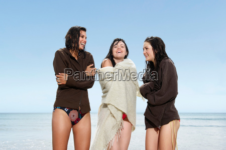 three girls by the sea