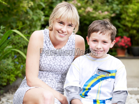 girl and boy sitting outside on