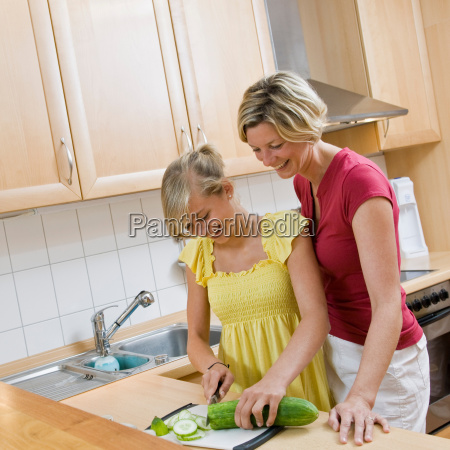 young girl and woman preparing meal