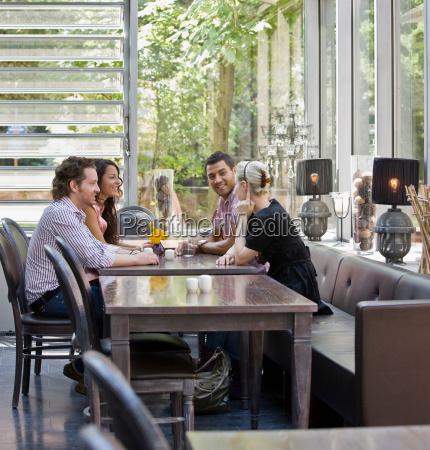 men and women talking over drinks