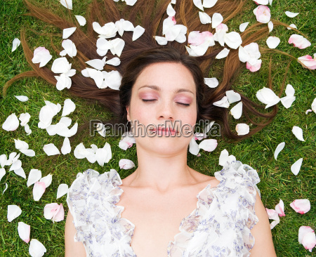 woman sleeping with rose pedals
