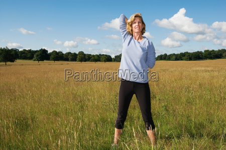 woman stretching arms behind back