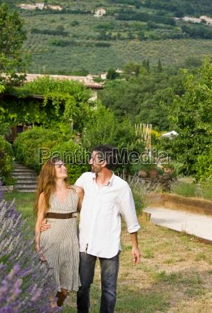 portrait of couple walking in garden