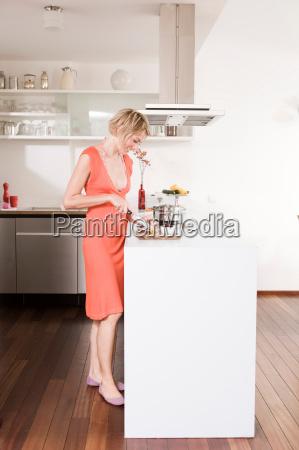woman preparing food in a kitchen