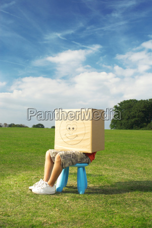 boy on stool with box on
