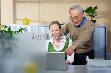 senior man and woman at office