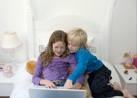 boy and girl on a bed