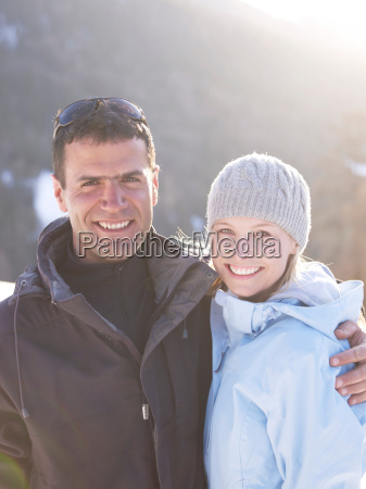 man and woman portrait on mountain