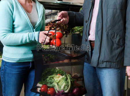 couple shopping for vegetables