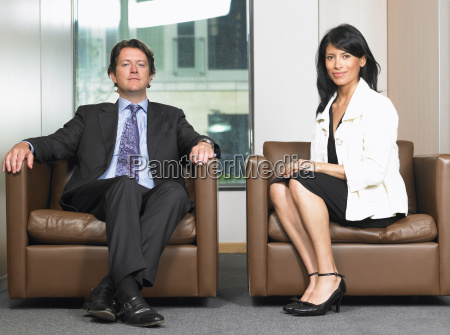 business man and woman in waiting