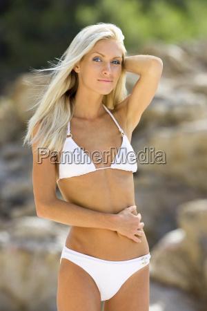a blond beach girl posing for