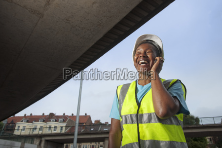 woman construction worker on phone