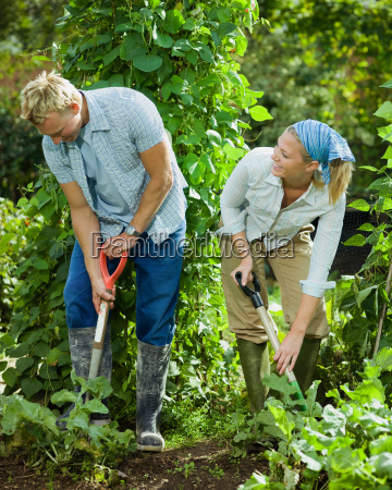 young couple working in a garden
