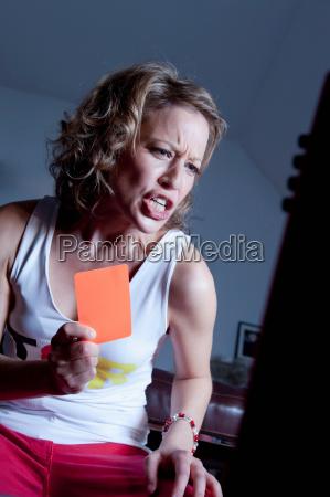 woman holding orange card