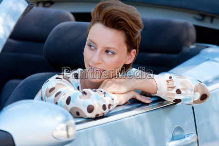 woman leaning out of car window